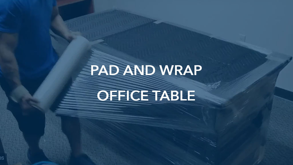 Video of how we pad and wrap a commercial office table for a relocation job